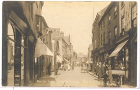 Photo:Postcard of Baxtergate, Loughborough.  The distinctive sign for the Rose and Crown can be seen on the left hand side