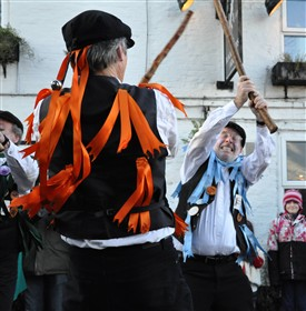 Photo:Chris Rose and Sam Millard, founder members, dancing The Turk's Head, a stick dance composed by Broadstone Morris, on Boxing Day 2010 at the Blacksmith's Arms, Everton