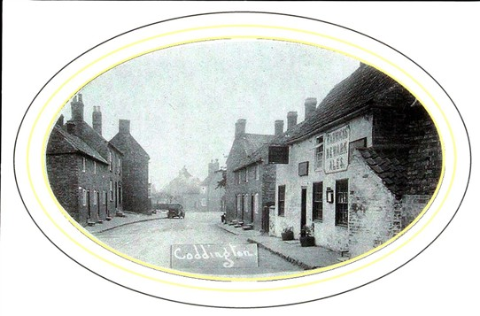 Photo:The Plough is the taller building in the distance on the left, the Red Lion is painted white on the right.