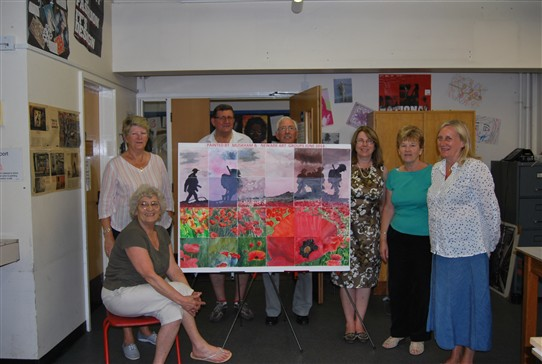 Photo:Members of the Newark & Muskham art groups with the finished work