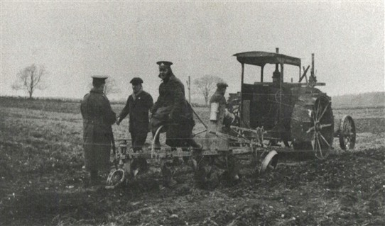 Photo:Uniformed soldiers assist with using an early tractor at Black Hills Farm, Edwinstowe