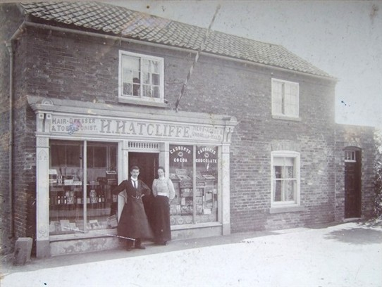 Photo:Hatcliffe's hairdressing shop with very prominent barber's pole