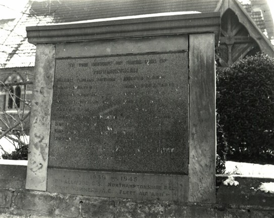 Photo:The war mememorial is in the wall outside the church