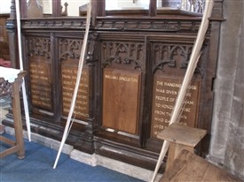 Photo:Names of the fallen inscribed at the base of the chancel screen