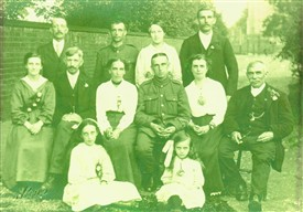 Photo:William Bell (centre, in uniform) came home from the trenches to attend this family wedding at Ordsall Church in August 1917