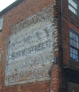 Photo:An advert for T. Tichmonds other shop (on Church Street in Southwell) is still visible high up on the side wall of the building.