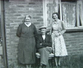 Photo:William Henry Allen with wife, Violet (left) and daughter Grace (right) in the early 1950s outside their home on Quibell Road, Hawtonville, Newark.
