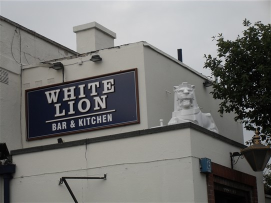 Photo:ABOVE; The Lion atop 'The White Lion' pub in Beeston