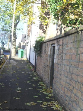 Photo:The gate and wall to the cemetery. The road at the top of the picture is Forest Road East.