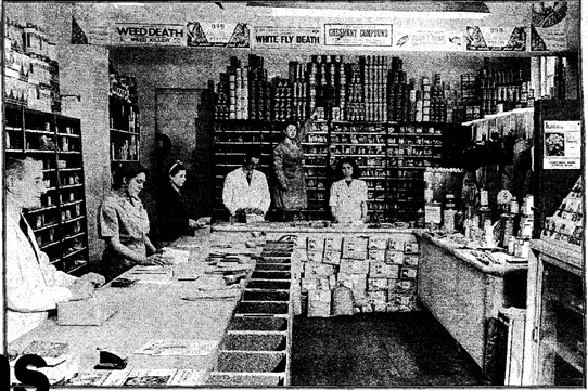 Photo:Middletons as it used to be -  this photograph taken in the early 1950s, shows Henry Middleton (rear) with staff in the Bridge Street store, including Fred Anderson (front left) who was shop manager for 44 years.