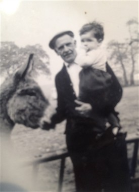 Photo:John French (Carol's brother) with Walt and the donkeys