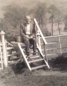 "Photo:Walt Hall.  Carol writes: ""this one is a rare one where he hasn't got his braces fastened with a pin or his flat cap on. He was one of the happiest, easy going men I've ever known""."