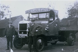 Photo:Mr Cecil Rawding (right) with his Hole's delivery vehicle AL 2424